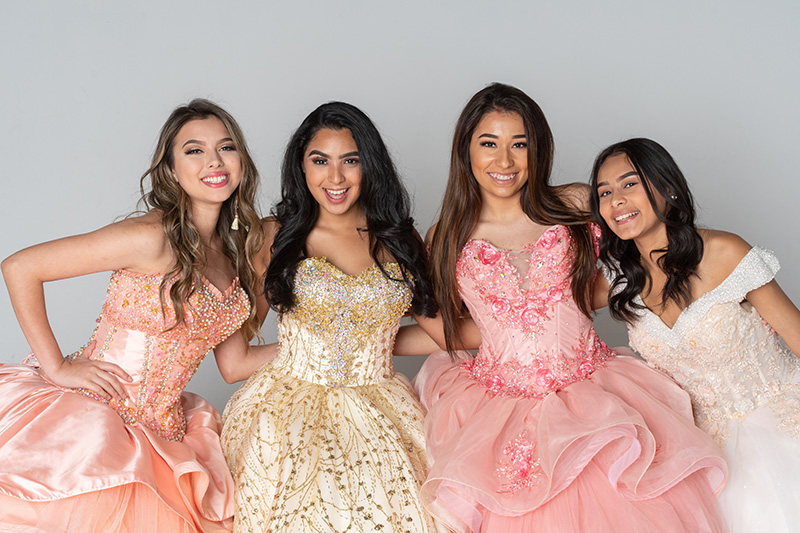 Girls Posing in Quinceanera Dresses