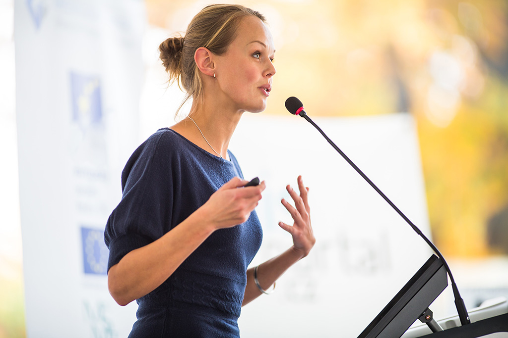 Woman speaking at event